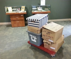 a pile of boxes of donated records