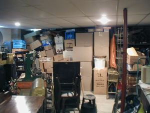 boxes and junk piled in a garage